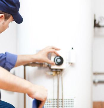 Repairman Fixing Water Heater